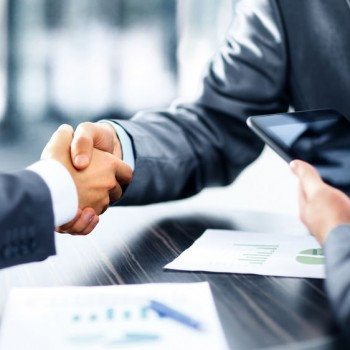 49572474 - business people shaking hands